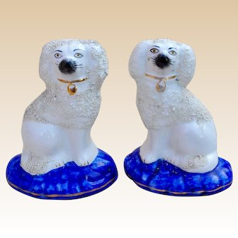 An unusual pair of Staffordshire pottery poodles, late 19th Century
