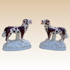 A rare and delightful pair of English porcelain models of English setters in exceptional condition, circa 1840