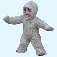 A large antique standing Snow Baby