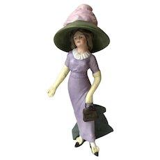 A rare German bisque Suffragette figure, circa 1910