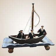 An amazing German mid 19th century toy of three men in a boat,
