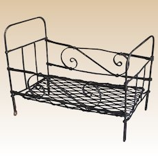 Wrought iron dolls' bed or large scale dolls' house bed,