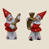 A pair of 1930s bisque Christmas cake decoration clown musicians,