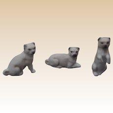Three antique bisque dolls' house pugs,