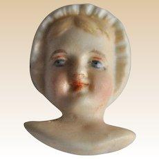Rare bisque dolls face in bonnet,