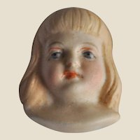 Rare bisque dolls face with blonde hair,