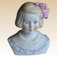 A beautiful German bisque shoulder-head of a little girl,