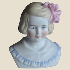 A beautiful German bisque shoulder-head of a little girl,