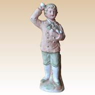 A Heubach bisque snowball thrower figure, circa 1910