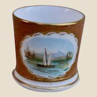An English miniature porcelain 1870s doll's mug,