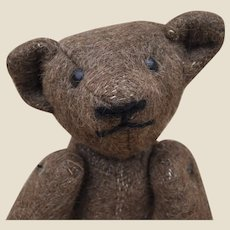 A lovely antique large eared early burlap teddy bear, probably American,