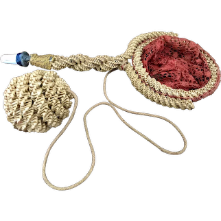 An unusual 19th century Corn Dolly cup and ball with whistle,