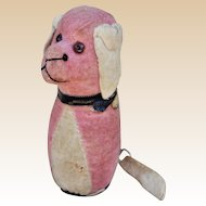 A rare German pink velvet dog tape measure pin cushion, 1930s