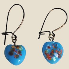 A genuine pair of antique turquoise heart earrings,