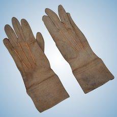 A pair of light brown large doll's or small child's gloves,