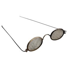 A very rare pair of antique doll's brass framed spectacles