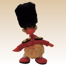 A lovely miniature woolen pom-pom duckling dressed as a guardsman, 1950s