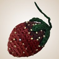 A lovely early needlework strawberry pin cushion, mid 19th century