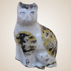 Early English Staffordshire pottery seated tortoiseshell cat, 19th century