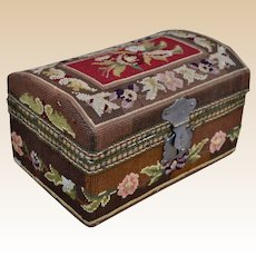 A beautiful antique tapestry covered dolls' trunk,