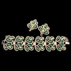 Signed Schiaparelli Green Rhinestone Gold Plated Wide Bracelet and Earrings