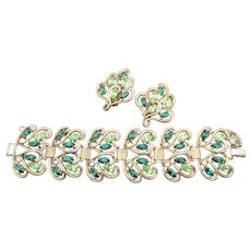 Signed Schiaparelli Green Rhinestone Gold Plated Wide Bracelet and Earrings