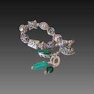 Essential Sterling Silver Charm Bracelet by Pilula Jula   'Greenback Boogie'