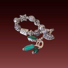 Essential Sterling Silver Charm Bracelet by Pilula Jula   'Greenback Boogie'
