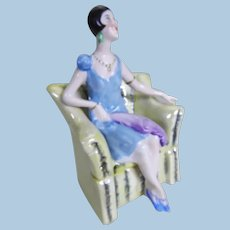 Art deco seated lady circa 1920