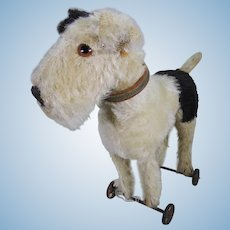 Steiff fox terrier on wheels.