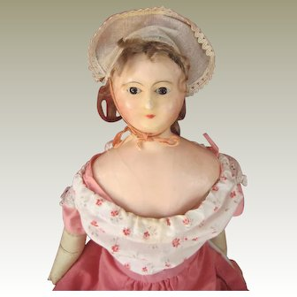 Wax over papier mache doll c.1850-60 with small breasts
