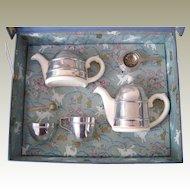 1951 Chrome covered child's tea set by  Kavin Kupid