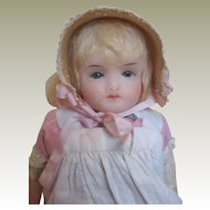 Wax over composition doll with original clothing