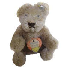 Steiff miniature bendy bear with button and chest tag.