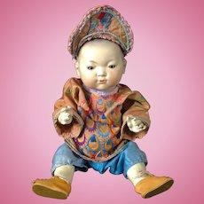 Oriental AM bisque headed baby marked Ellar
