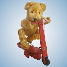 Mechanical wind up Bear on scooter