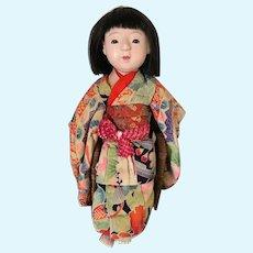 Japanese doll wearing lovely original Kimono