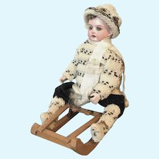 German Doll on Sled Candy Container