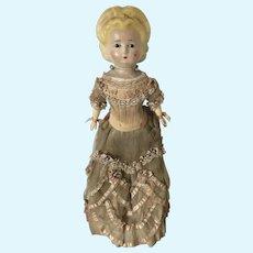 Wax over papier maché Pumpkin doll with fabulous clothing
