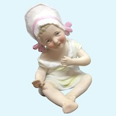 German bisque baby wearing bonnet