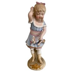 German Heubach figure of child with doll