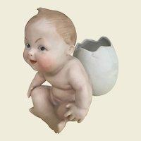Heubach cheeky child with egg posy vase