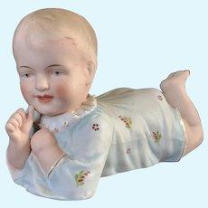 German Piano baby of reclining boy