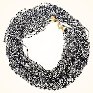 Joan Rivers- Signed Torsade Necklace Black And White 24-strand Czech Glass Seed Beads