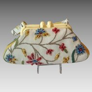 Crewel work and leather purse