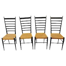 A set of 4 ladder back chairs.