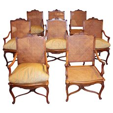 Early 20th Century French Regence Style Walnut Arm Chairs - A Set of 8