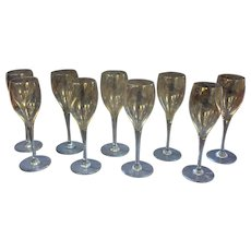 A Set of 9 Baccarat White Wine Glasses