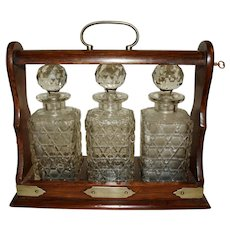 Late 19th Century English Tantalus with Decanters - A Set