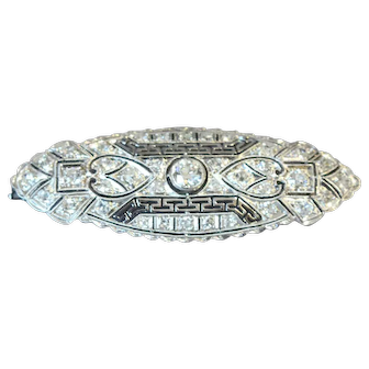 A white gold & diamond pin